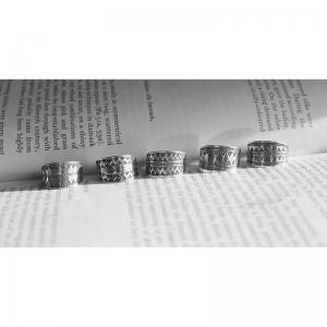 58. Кольца женские с чеканным орнаментом